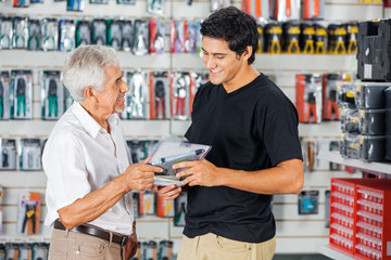 Father And Son Buying Drill In Store