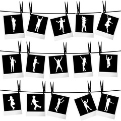 Collection of photo frames hanging on rope with children silhoue