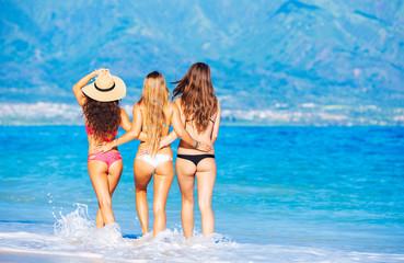 Beautiful Girls Having Fun Walking on the Beach