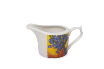 Pottery milk jug over white background