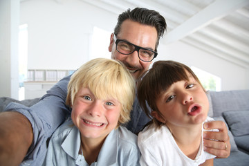 Dad with kids taking picture of themselves
