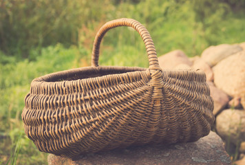 vintage Empty basket  on green lawn