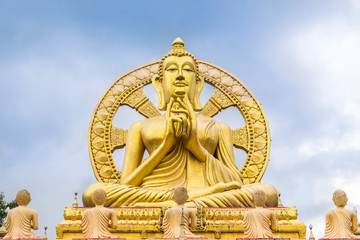 big  golden buddha statue  with wheel of dhamma