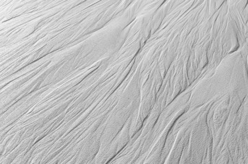 Traces of flowing water on the sand