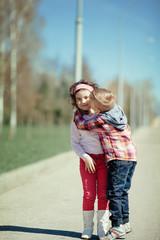 little boy kiss girl on the street