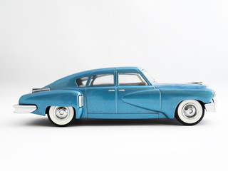Classic Retro Streamlined Blue Sedan