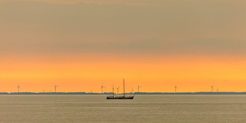 Panoramic image of a sailing boat at the Dutch Markermeer