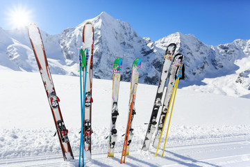 Fototapete - Skiing , mountains and ski equipments on ski run