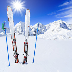 Fototapete - Skiing, winter season , mountains and ski equipments on ski run
