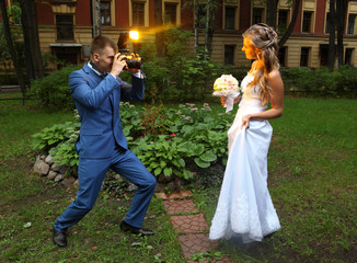 Wedding Photographer Taking Picture bride, camera flash flashing