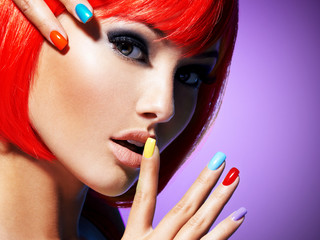 Face of glamour fashion model with bright colored  nails.