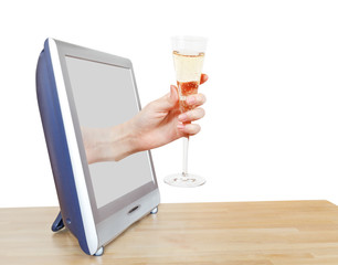 hand holding glass with champagne leans out TV