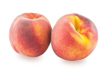 Two peaches on a white background