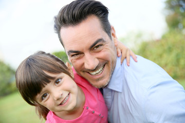Portrait of little girl hugging her daddy