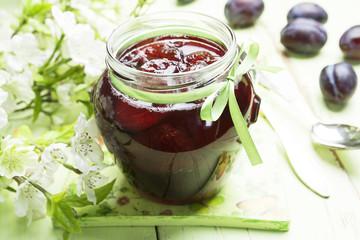Plum jam in a glass jar