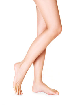 Beautiful woman legs isolated on white.