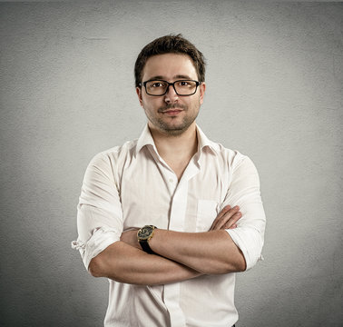 Portrait of successful business guy in stylish eyeglasses
