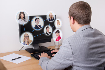 social network concept - business man using computer in office