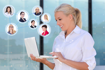 social network concept - business woman with laptop in the stree