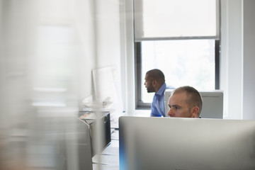 Two men working in an office