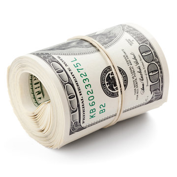 Hundred dollar bills rolled up with rubberband. Clipping Path..