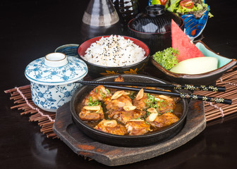 japanese cuisine. hot plate chicken on the background