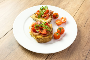 Plate With Italian Bruschetta On Table