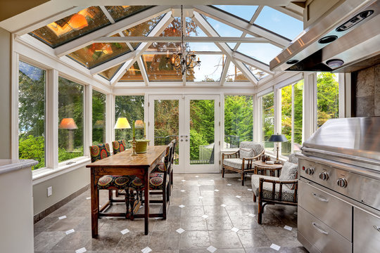 Sunroom patio area with transparent vaulted ceiling