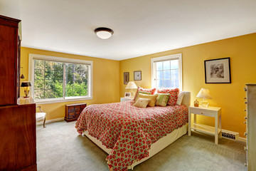 Cheerful bedroom interior in bright yellow color