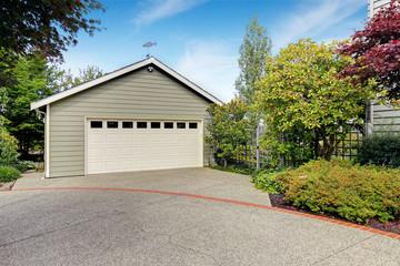 Garage with concrete driveway