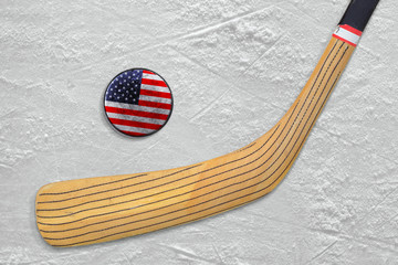 Hockey stick and puck on an American hockey rink
