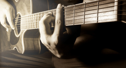 Playing acoustic guitar,guitarist or musician