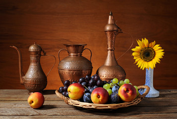 Fresh fruit in basket wicker and metal dishes