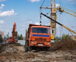 Construction site. Truck, excavator, crane.