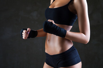 Beautiful fit woman model in black hand bandage