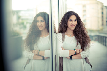 beautiful curly long brunette hair moroccan woman