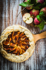 Apple pie on rustic wooden background