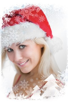 Composite image of pretty woman wearing stanta hat