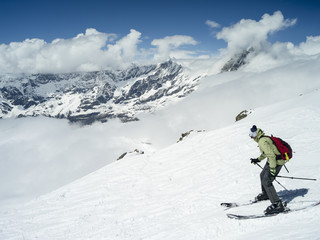 alone skiers and winter landscape