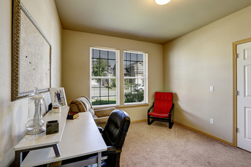 Simple office room with white desk