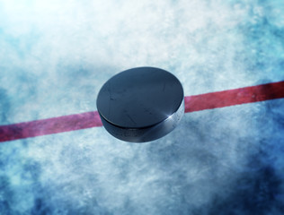 Hockey puck above the ice with red line