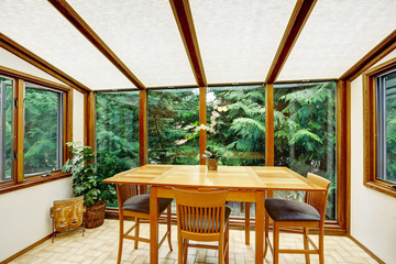 Beautiful dining area with transparant glass wall