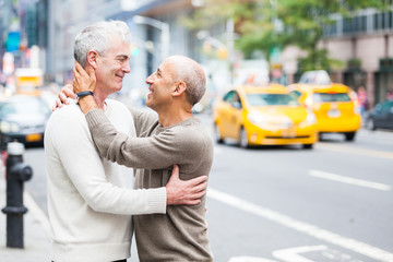 Gay Couple with Traffic on Background in New York