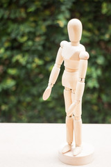 Wooden artist manikin pose on the table