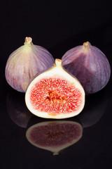 fruits of fresh figs isolated on black  background