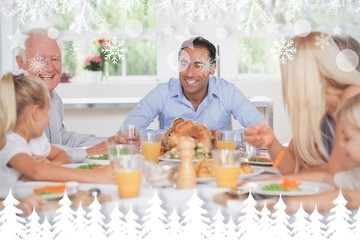 Composite image of happy family at thanksgiving