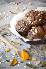 homemade muffins with pumpkin chocolate and oat flakes