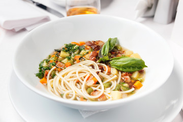 Chicken soup with pasta and vegetables.