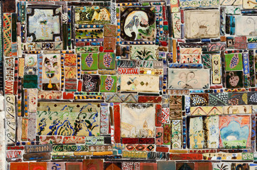 Beautiful colourful handmade ceramic tile with various ornament