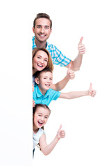 Young family with a banner showing the thumbs-up
